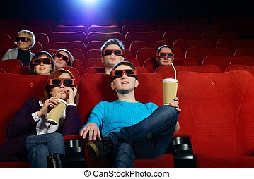 Group of people in 3D glasses watch