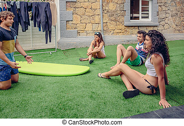 Group of people in a summer surf class