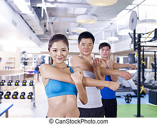 group of people in aerobics class