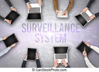 Group of people in front of a laptop, security concept