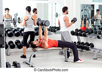 group of people in sport fitness gym weight training...
