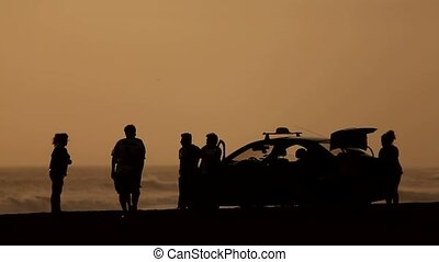 Group of people in sunset at beach