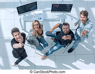 group of people in the office looking up