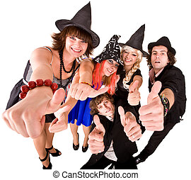 Group of people in  witch costume with thumbs up.