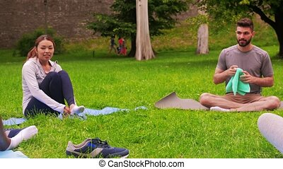 group of people meeting for yoga class at park