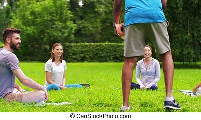 group of people meeting for yoga class at park - fitness, ...
