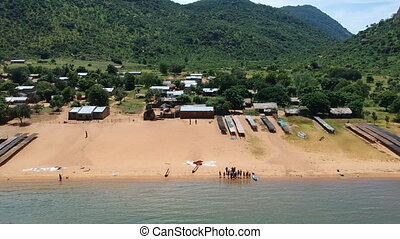 Group of People on Beach of Lake Malawi