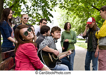 Group of people on city. Music. - Group of people on city in...