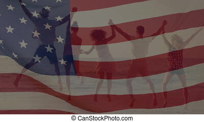 Group of people on the beach with an American flag