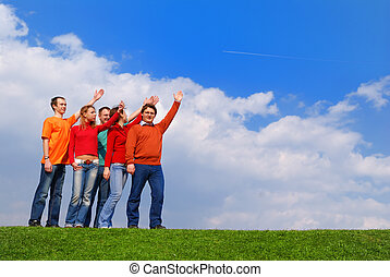Group of people pointing to sky