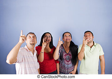 Group of people pointing up to copyspace