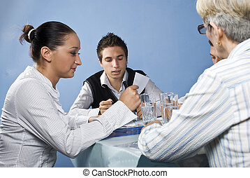 Group of people reading at business meeting - Group of...