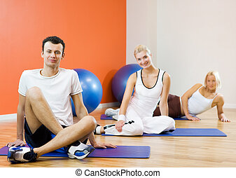Group of people relaxing after fitness exercise