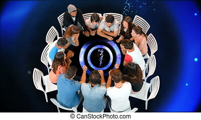 Group of people seated in a circle table