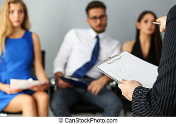Group of people sit on casting chairs row at boss reception