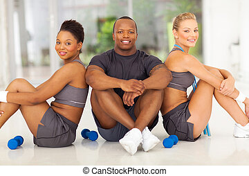 group of people sitting after working out - group of healthy...