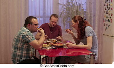 Group of people sitting at the table and dinner