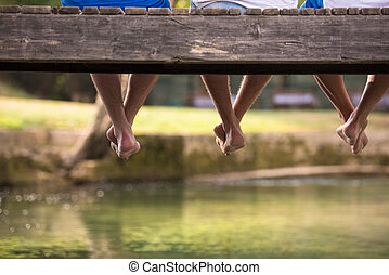people sitting at wooden bridge