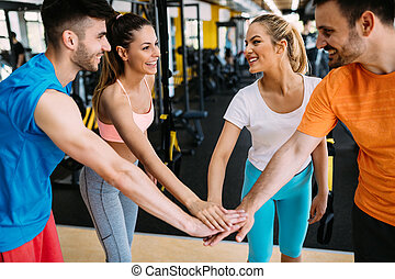 Group of people training in gym