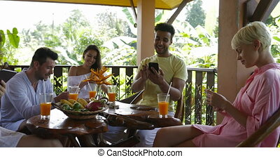 Group Of People Using Cell Smart Phones Surfing Internet Social Media Communciation Concept, Friends Chatting Online Sitting At Table On Terrace