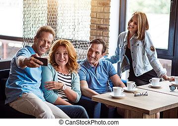 Group of people using digital tablet