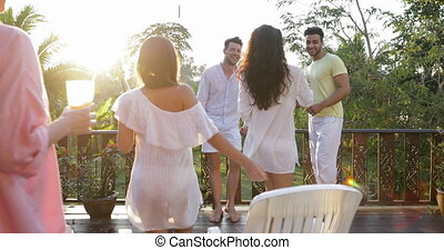 Group Of People Walking On Summer Terrace At Sunset, Talking, Friends Communication Outdoors