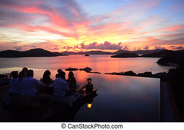 group of people watching the sunset, Celebration Beach Party