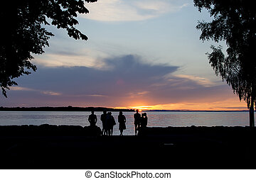 Group of people watching the sunset.