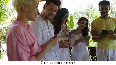 Group Of People With Cell Smart Phones Messaging Outdoors On...