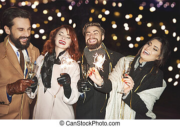 Group of people with champagne flute enjoying together
