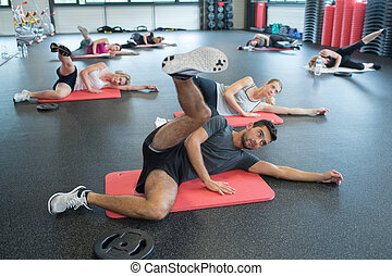group of people working out in fitness class