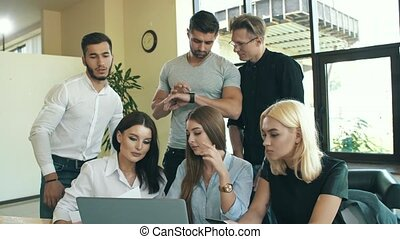 Group of people working together with laptop