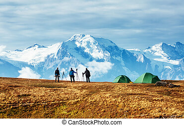 Group of photographers watching spectacular view of the snow ridge. Location place Mestia, Svaneti, Georgia, Europe. High Caucasus ridge.