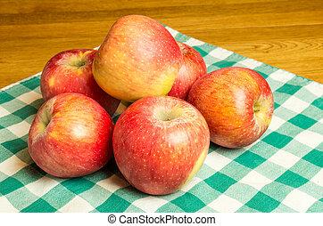 Group of Pinova apples - Pinova apples on checked cloth