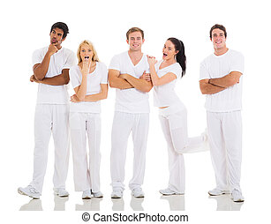 group of playful friends posing on white
