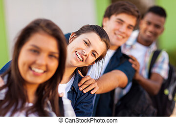 group of playful high school students close up