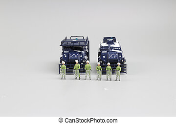 group of police figure with Armored car