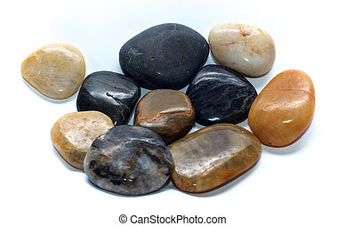 group of polished stones over white