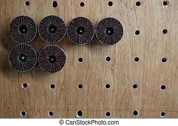 polishing wheels on the wood board