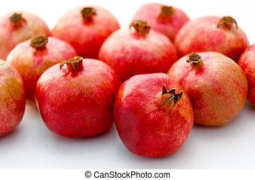 Group of pomegranates on white background