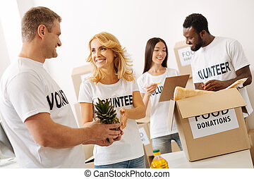 Group of positive enthusiastic people working pro bono