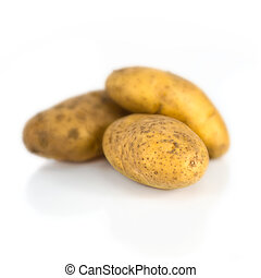Group of potatoes isolated over white background