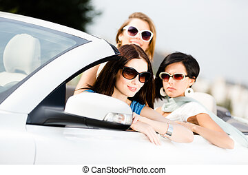 Group of pretty teenagers in the car