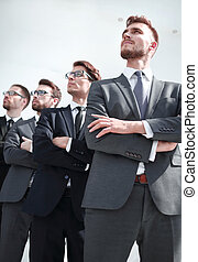 group of professional company employees looking at a copy space