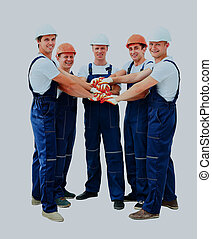 Group of professional construction workers