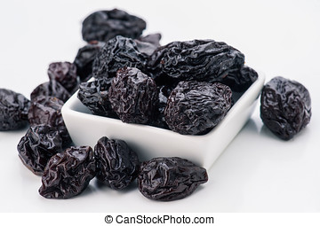 group of prunes in small porcelain tray
