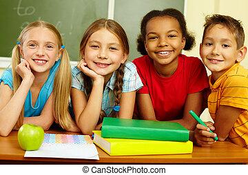 Group of pupils - Portrait of smart schoolchildren looking...