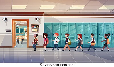 Group Of Pupils Walking In School Corridor To Class Room,...