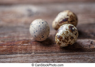 Group of quail eggs on thewooden background