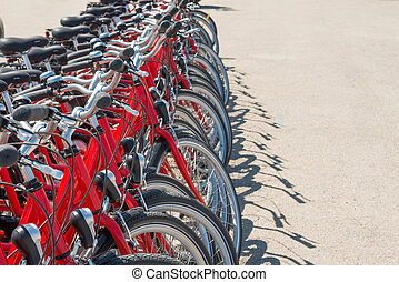 Group of red city bicycles